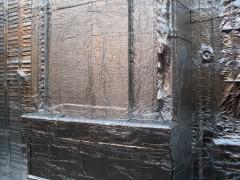 Fachada cubierta con membrana asfáltica aluminizada
