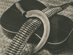 Sickle, Bandolier and guitar ca. 1927