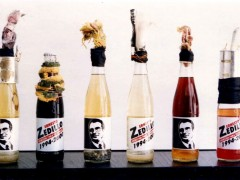 Vincente Razo, Revolucionario institucional, 1994, Molotoc cocktails in six propagandas glass botles and mixed medias, dimensions variables, Courtesy of the artist