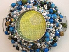 Mixed Media = Mirror, faux pearls, tagua and chonta beads, beads hand beaded on kitchen strainer 10 x 12 inches