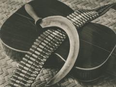 Sickle, Bandolier and guitar ca. 1927