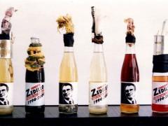 Vincente Razo, Revolucionario institucional, 1994, Molotoc cocktails in six propagandas glass botles and mixed medias, dimensions variables, Courtesy of the artist